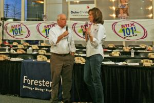 Mix 101.5 morning show hosts Bill Jordan and Lynda Loveland keep the audience entertained while waiting to learn the total amount collected during the radio-thon.