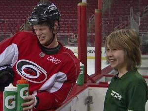 Connor Johnson, a 13-year-old Non-Hodgkin's Lymphoma patient, squirted a water bottle at Eric Staal during a visit arranged by the Make-a-Wish Foundation.