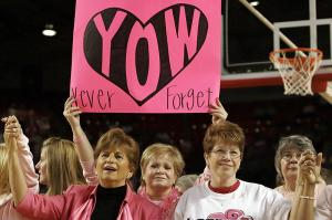 """Cancer survivors who were honored at halftime celebrate life and perseverance while listening to a halftime performance of """"Never Give Up."""""""