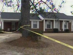 Yellow crime scene tape surrounds the home of Lola Nye, on South Creek Road in Orrum, southeast of Lumberton in Robeson County. A state trooper found Nye severely beaten in the home Sunday, Feb. 15, 2009.