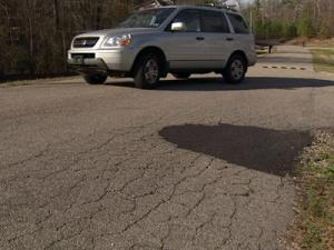 Residents in the Meadow Glenn subdivision in Wake County say they are frustrated that road repairs in the neighborhood are not being made as they would like.