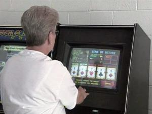 A person plays a video poker machine.