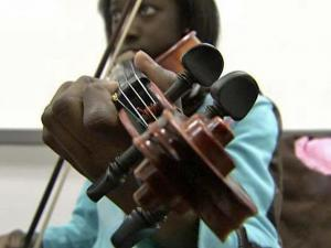 A student practices the violin at the Community Music School in downtown Raleigh. Former city councilwoman founded the school 15 years ago with the goal of making private music lessons available to children from lower-income families.