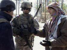 Some of the people playing the role of Iraqi villagers are real Iraqis who work for the U.S. military as interpreters.