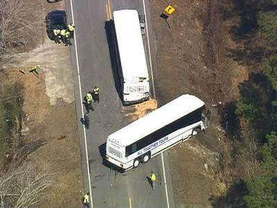 Authorities try to clear the wreckage of buses carrying Camp Lejeune Marines from U.S. 17 in Jones County on March 5, 2009.