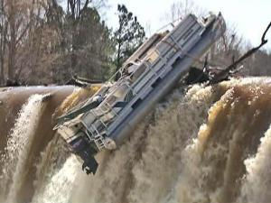 The floodgates to a dam on the Tar River Reservoir opened, and a stuck pontoon boat plunged down 25 feet Monday, March 9, 2009. The boat, which had been stuck on the dam for five days, stayed intact.