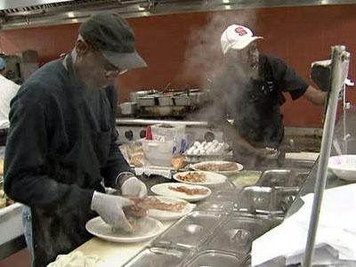 Employees cook in newly renovated kitchen at the State Farmer's Market restaurant on March 14, 2009. The restaurant just reopened after a two-month hiatus.