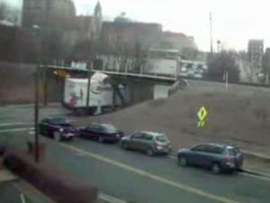 A truck crashes into the Gregson Street bridge in Durham. (Photo courtesy of YouTube.com)