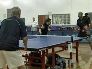 Athletes compete in the 9th annual Butterfly Cary Cup Table Tennis Championship at the Bond Park Community Center in Cary on March 20, 2009.