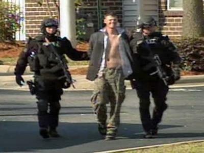 Authorities arrest Jason Johnson after a standoff Tuesday.