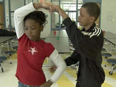 Students dance together in Washington Elementary School's ballroom dancing club.