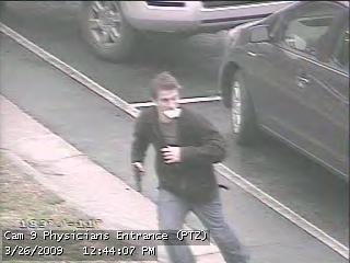 A hospital surveillance camera photo obtained by WRAL News shows a white man with what appears to be a gun heading toward the physician's entrance of Maria Parham Medical Center.