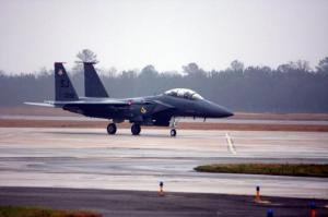 As rainy weather starts the base tour an F-15E Strike Eagle fighter craft is taxiing to the runway.