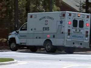 A Moore County EMS ambulance pulls up to the Pinelake Health and Rehab Center in Carthage, Sunday, March 29, 2009, where seven residents and a nurse were killed in a shooting.