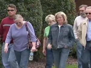 Family members of some of the victims of the March 29 nursing home shooting rampage leave following a March 31 meeting with the Moore County district attorney.