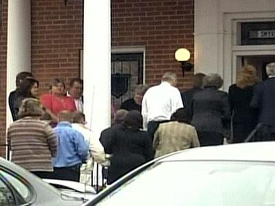 Dozens of mourners file into Smyrna Methodist Church near Robbins to remember Tessie Garner, 75, one of eight people killed in a nursing home shooting on March 29, 2009.