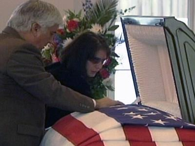 Jill DeGarmo, Jerry Avant Jr.'s fiancee, says goodbye to her husband-to-be at his funeral on April 2, 2009. The two were to be married in August.