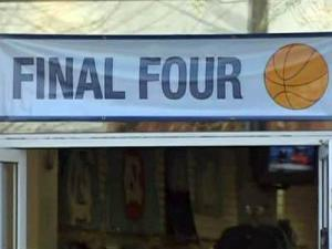 A banner hangs above the doorway of a store on Franklin Street in Chapel Hill.