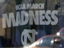 A banner hangs in the window of a store on Franklin Street in Chapel Hill.