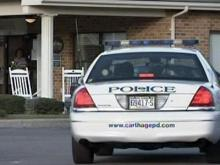 Police on the scene of a mass shooting at Pinelake Health and Rehab Center in Carthage on March 29, 2009.