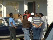 Family members of 6-year-old Ca'zhia McMillian gathered after authorities found the body of the child in the Lower Little River on April 4, 2009. The child had been missing for two weeks.