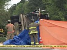 Woman pinned after dump truck overturns