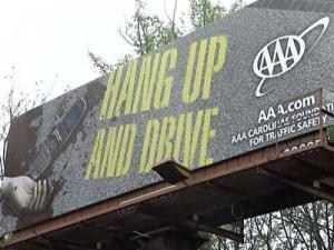 Billboards depicting a bloody crash are part of a AAA Carolinas campaign to keep drivers from using cell phones while driving.