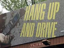 Graphic billboards warn against cell phones and driving