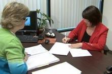 Mortgage consultant Sharon Whitlatch helps Rhonda Matney refinance her home loan.