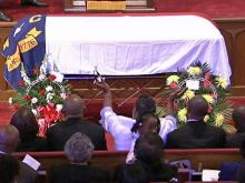 Mourners cheer Malone's life of service