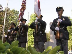 A tribute service was held at a monument to fallen Raleigh police officers in Nash Square before the first Run for Our Heroes race Saturday, April 25, 2009.