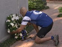 A wreath was laid at a monument to fallen Raleigh officers in Nash Square during a memorial service Saturday, April 25, 2009.