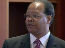 Shaw tries to restore finances with new president