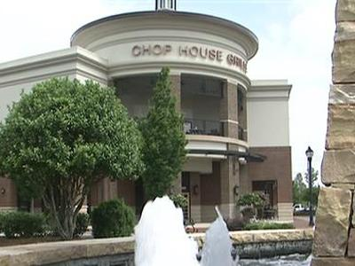 Keith Hall said he placed a banner outside the Chop House Grille in Cary but was asked to remove it or pay a daily fine of $500. He and other business owners say the town should relax its sign ordinance during the recession.