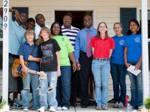 Members of Habitat for Humanity of Durhams Youth United stand in front of one of the third homes they have built in the past three years. (Submitted by Habitat for Humanity of Durham)