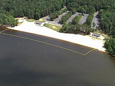 Sandling Beach at Falls Lake was one of two swimming areas closed Friday because of high levels of bacteria.
