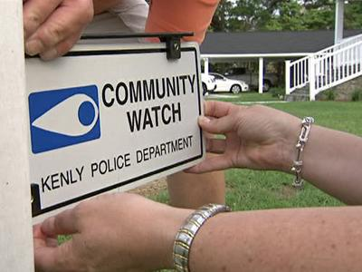 Kenly residents put up town-watch signs.