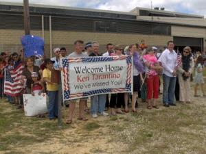 Family and friends eagerly await the return of their loved ones at Pope Air Force Base, NC. Soldiers from the 528th Medical Detachment (Combat Stress Control,) the 602nd Area Support Medical Company, the 609th Movement Control Team, and Marines from the 2nd Marine Expeditionary Brigade returned home on June 6th. (Submitted by Maj. Kristian Sorensen)