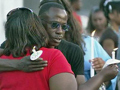 About 400 people attended a candlelight vigil for ConAgra Foods employees Friday night at Wake Baptist Grove Church, at 302 E Main St. in Garner.