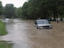 Flooding damages homes, stands motorists