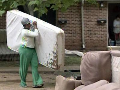 Residents at Brookhill Townhouse Apartments in Raleigh were disposing of flood-damaged items on June 17, 2009.