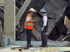 Inspectors survey damage as they try to determine the cause of the gas leak at ConAgra Foods and how that sparked the explosion.