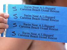 Colored wristbands to find lost kids at beach