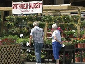 Shoppers search for plants at the State Farmers Market in Raleigh.