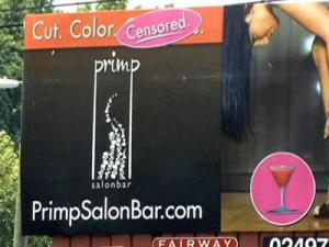 "Primp SalonBar owner Lainie Panos has covered up the word ""cocktails"" from her company's billboard because of a violation of state law."
