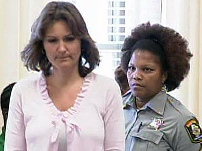 Sandra McMillan is escorted into an Edgecombe County courtroom June 29, 2009, to plead guilty to second-degree murder in the death of her stepson, Tyler McMillan.