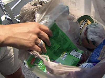 Vacationers donate food to soup kitchen.
