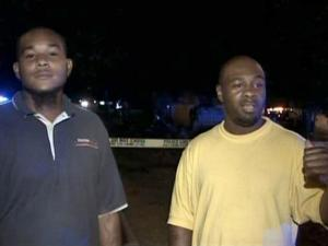 Paul Godette and Mike Dickens, both of Raleigh, (left to right) talk about rescuing a Fort Bragg soldier from a burning car after a single-vehicle wreck on New Bern Avenue around midnight Thursday, July 2, 2009. The 19-year-old soldier from Massachusetts was listed in critical but stable condition. Police planned to charge him with driving while impaired.