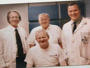 Jim Edwards (bottom, center) poses in a photo with his doctors at the North Carolina Jaycees Burn Center at UNC Hospitals in Chapel Hill. Edwards was seriously injured and spent nearly three months in a medical coma at the Jaycees Burn Center after the West Pharmaceuticals plant in Kinston exploded in 2003.