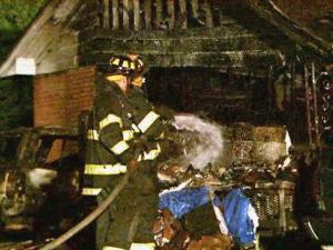 Smithfield Fire Marshal Paul Whitehurst credited a police officer with getting a family of five safely out of a burning house at 1411 W. Market St.   the early hours of Monday, July 13, 2009. It appears that the fire started in a vehicle under the carport and spread to the house.